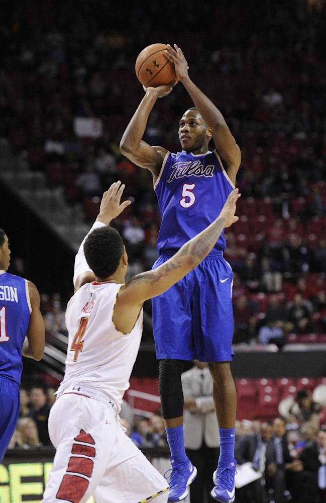 Tulsa guard Tim Peete (5) shoots against Maryland guard Seth Allen (4) during the first half of an NCAA college basketball game on Sunday, Dec. 29, 2013, in College Park, Md