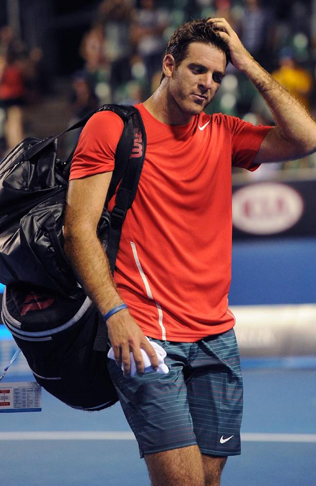 In this Jan. 16, 2014 file photo, Juan Martin del Potro of Argentina, walks off the court after losing to Roberto Bautista Agut of Spain in their second round match at the Australian Open tennis championship in Melbourne, Australia. After missing most of the season with a wrist injury, del Potro announced Tuesday, Oct. 14, 2014, that he will not play for the remainder of the year but plans to return to the court in 2015