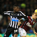 Burnley's Kieran Trippier, right, and Newcastle United's Sammy Ameobi vie for the ball during their English Premier League match at Turf Moor, Burnley, England, Tuesday Dec. 2, 2014