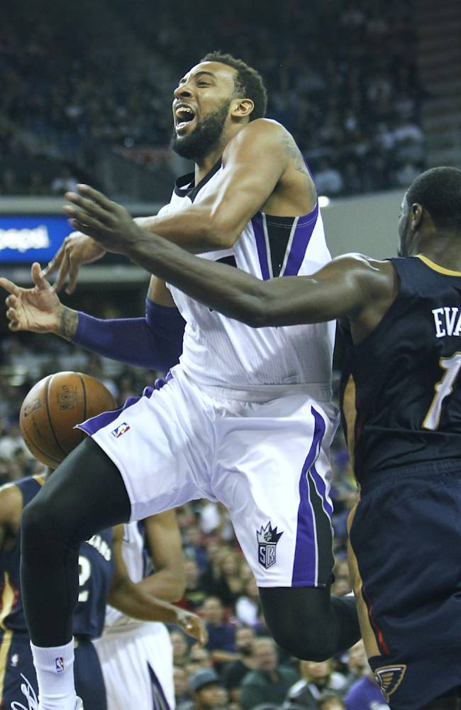 Sacramento Kings forward Derrick Williams, left, is fouled while driving  to the basket by New Orleans Pelicans defender Tyreke Evans during the second half of an NBA basketball game in Sacramento, Calif.,  on Monday, Dec. 23, 2013. The Pelicans won 113-100