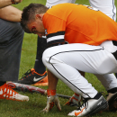 Oklahoma State's Garrett McCain is attended to after being hit with a pitch in the seventh inning of the championship game of the NCAA college Big 12 conference baseball tournament in Tulsa, Okla., Sunday, May 24, 2015. Texas won 6-3. (AP Photo/Sue Ogrocki)