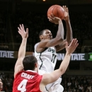 Michigan State's Keith Appling (11) shoots over Ohio State's Aaron Craft (4) during the first half of an NCAA college basketball game, Saturday, Jan. 19, 2013, in East Lansing, Mich. (AP Photo/Al Goldis)