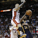 Indiana Pacers' Paul George (24) looks to the basket before being fouled by Miami Heat's Chris Andersen, top, during the first half of an NBA basketball game, Friday, April 11, 2014, in Miami The Associated Press