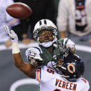 In a Sept. 22, 2014, file photo, New York Jets wide receiver Jeremy Kerley goes up for a pass into the end zone against Chicago Bears strong safety Brock Vereen (45) during the fourth quarter of an NFL football game in East Rutherford, N.J. The New Yor