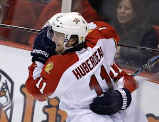 Florida Panthers center Jonathan Huberdeau (11) celebrates his go-ahead goal with defenseman Tom Gilbert during the third period of an NHL hockey game against the Detroit Red Wings in Detroit, Saturday, Dec. 7, 2013. (AP Photo/Carlos Osorio)