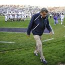 FILE - In this Oct. 22, 2011 file photo, Penn State coach Joe Paterno walks off the field after warmups before an NCAA college football game against Northwestern in Evanston, Ill. NCAA president Mark Emmert says he isn't ruling out the possibility of shutting down the Penn State football program in the wake of the Jerry Sandusky child sex abuse scandal. In a PBS interview Monday night, July 16, 2012, he said he doesn't want to