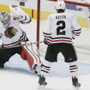 Chicago Blackhawks defenseman Duncan Keith (2) looks on as goalie Corey Crawford (50) is unable to stop a shot from Dallas Stars forward Cody Eakin, not pictured, in the second period of an NHL hockey game, Thursday, Oct. 9, 2014, in Dallas The Associated