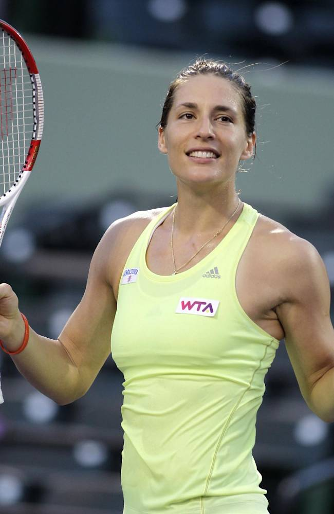 Andrea Petkovic, of Germany, dances for the crowd after defeating  Maria-Teresa Torro-Flor, of Spain, 6-3, 6-4 during the Sony Open tennis tournament, Wednesday, March 19, 2014, in Key Biscayne, Fla