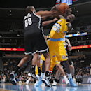 Brooklyn Nets center Jason Collins, left, fouls Denver Nuggets forward J.J. Hickson as he goes up for a shot in the fourth quarter of the Nets' 112-89 victory in an NBA basketball game in Denver on Thursday, Feb. 27, 2014 The Associated Press