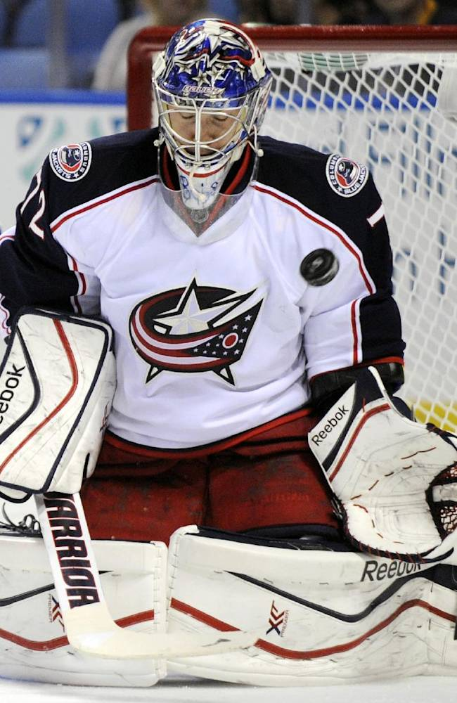 Columbus Blue Jackets goaltender Sergei Bobrovsky, of Russia, makes a save against the Buffalo Sabres during the first period of an NHL hockey game in Buffalo, N.Y., Thursday, Oct. 10, 2013. Columbus won 4-1