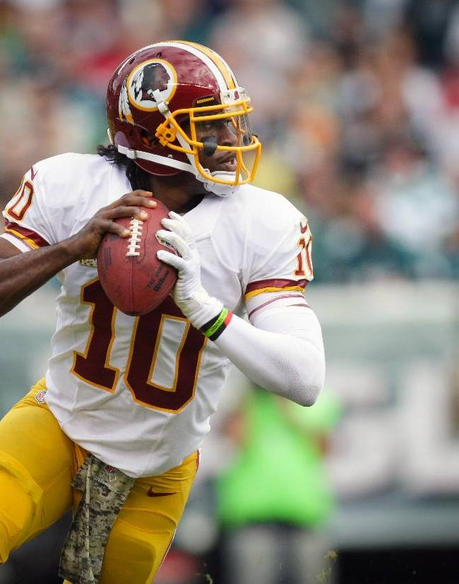 Washington Redskins quarterback Robert Griffin III looks to pass against the Philadelphia Eagles during the first half of an NFL football game in Philadelphia, Sunday, Nov. 17, 2013