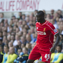 Liverpool's Mario Balotelli runs with the ball during their English Premier League soccer match against Tottenham Hotspur, at White Hart Lane, London, Sunday, Aug. 31, 2014