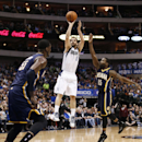 Indiana Pacers shooting guard Rasual Butler (8) shoots the ball over Indiana Pacers' Roy Hibbert (55) and Donald Sloan (15) during the first half of an NBA game, Sunday, March 9, 2014, in Dallas, Texas The Associated Press