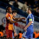 Chelsea's John Terry, right goes to embrace his former teammate Galatasaray's Didier Drogba at the end of the Champions League last 16 second leg soccer match between Chelsea and Galatasaray at Stamford Bridge stadium in London, Tuesday, March 18, 2014