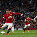 Manchester United's Wayne Rooney misses a penalty during his team's pre season friendly soccer match against Valencia at Old Trafford Stadium, Manchester, England, Tuesday Aug. 12, 2014