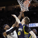 Providence forward LaDontae Henton (23) shoots a basket through the defense of Marquette center Luke Fischer (40) and guard Jajuan Johnson (23) during the second half of an NCAA college basketball game Sunday, March 1, 2015, in Providence, R.I. Providence defeated Marquette, 77-66. (AP Photo/Stew Milne)