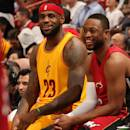 MIAMI, FL - DECEMBER 25: LeBron James #23 of the Cleveland Cavaliers and Dwyane Wade #3 of the Miami Heat converse during a game at the American Airlines Arena on December 25, 2014 in Miami, Florida. (Photo by Issac Baldizon/NBAE via Getty Images)