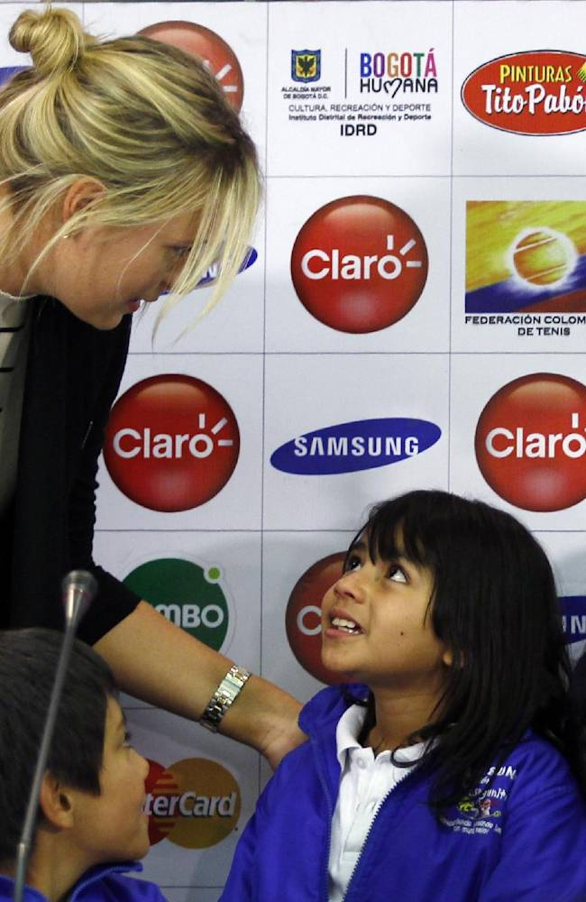 Russian tennis player Maria Sharapova talks with children of