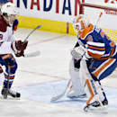 Arizona Coyotes Shane Doan (19) is stopped by Edmonton Oilers goalie Ben Scrivens (30) during second period NHL hockey action in Edmonton, on Sunday, Nov. 16, 2014 The Associated Press