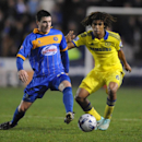 Shrewsbury's Bobby Grant, left, holds back Chelsea's Nathan Ake, during the Fourth Round of the English League Cup soccer match between Shrewsbury Town and Chelsea at Greenhous Meadow, Shrewsbury, England, Tuesday, Oct. 28, 2014