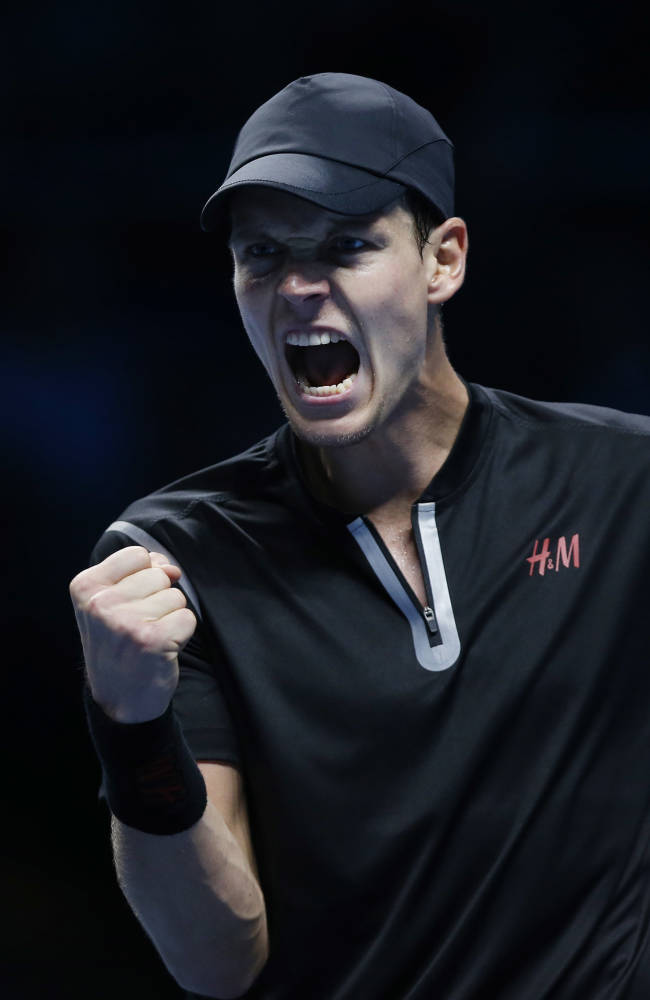 Tomas Berdych of Czech Republic shouts after winning a set against Stanislas Wawrinka of Switzerland during their ATP World Tour Finals single tennis match at the O2 Arena in London Monday, Nov. 4, 2013
