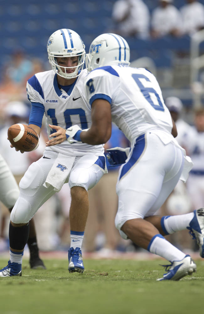 Middle Tennessee quarterback Logan Kilgore (10) hands the ball off to Jordan Parker (6) during the first half of a NCAA football game against Florida Atlantic in Boca Raton, Fla., Saturday, Sept. 21, 2013