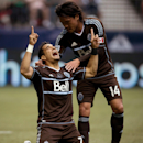 Vancouver Whitecaps' Camilo Sanvezzo, left, of Brazil, celebrates with Daigo Kobayashi, of Japan, after scoring a goal against the New England Revolution during the first half of an MLS soccer game in Vancouver,  British Columbia on Saturday June 15, 2013.  (AP Photo/The Canadian Press, Darryl Dyck)