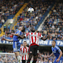 Chelsea's Cesar Azpilicueta, left, jumps for the ball with Sunderland's Jozy Altidore during their English Premier League soccer match at the Stamford Bridge ground in London, Saturday, April 19, 2014. Sunderland won the match 2-1