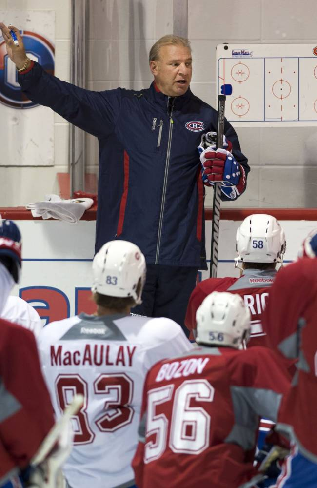 Montreal Canadiens head coach Michel Therrien explains a drill during the team's NHL hockey training camp, Thursday, Sept. 12, 2013 in Brossard, Quebec