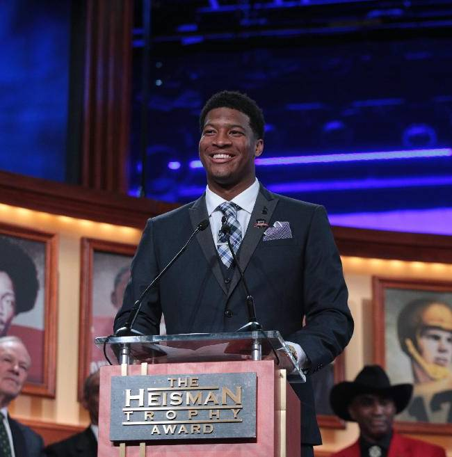 In this photo provided by the Heisman Trust, Florida State quarterback Jameis Winston talks after winning the Heisman Trophy during the Heisman Trophy presentation in New York on Saturday, Dec. 14, 2013. Winston, 19, is the youngest winner of the trophy and the second straight player to win the prestigious award in his first year of college