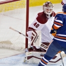 Arizona Coyotes goalie Devan Dubnyk (40) makes the save on Edmonton Oilers Teddy Purcell (16) during second period NHL hockey action in Edmonton, on Sunday, Nov. 16, 2014 The Associated Press