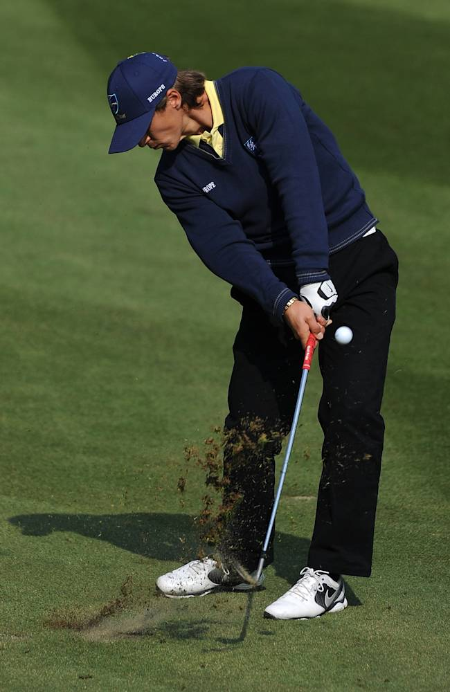 Thorbjorn Olesen of Denmark chips the ball on the ninth hole during the Four-Ball Match, at the Royal Trophy Europe vs Asia Golf Championship at Dragon Lake Golf Club in Guangzhou, in southern China's Guangdong province, Saturday, Dec. 21, 2013. Europe's team consists of Austria's Bernd Wiesberger and Denmark's Thorbjorn Olesen and Asia's team consists of Japan's Ryo Ishikawa and Hiroyuki Fujita. (AP Photo)