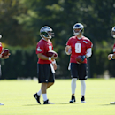 Philadelphia Eagles quarterbacks G.J. Kinne (4), Matt Barkley (2), Nick Foles (9), and Mark Sanchez (3) are seen during NFL football practice at the team's training facility, Tuesday, Sept. 23, 2014, in Philadelphia. The Associated Press