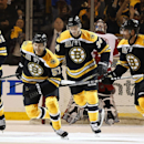 Boston Bruins' Justin Florek (57) leads the charge to the bench with teammates Andrej Meszaros (41), Carl Soderberg (34) and Johnny Boychuk after scoring against the Detroit Red Wings during the first period of Game 2 of a first-round NHL hockey playoff s