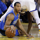Dallas Mavericks' Devin Harris, left, recovers the ball from between the legs of Golden State Warriors' Draymond Green (23) during the first half of an NBA basketball game, Tuesday, March 11, 2014, in Oakland, Calif The Associated Press