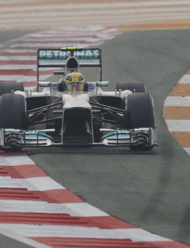Mercedes driver Lewis Hamilton of Britain steers his car wide during the second practice session at the Indian Formula One Grand Prix at the Buddh International Circuit in Noida, India, Friday, Oct. 25, 2013