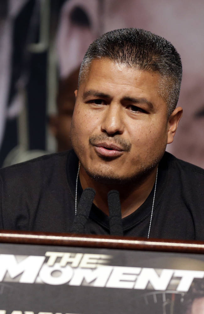 Trainer Robert Garcia speaks during a news conference on Wednesday, April 30, 2014, in Las Vegas. Marcos Maidana is to square off with Floyd Mayweather Jr. in a welterweight title fight on Saturday, May 3
