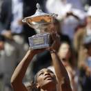 Serena Williams, of the United States, poses with the trophy after winning her final match against Belarus' Victoria Azarenka at the Italian Open tennis tournament in Rome, Sunday, May 19, 2013.  Williams won her fourth consecutive title of the year in dominating fashion Sunday, beating third-seeded Victoria Azarenka 6-1, 6-3 in the Italian Open final. (AP Photo/Andrew Medichini)