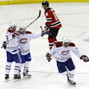 Montreal Canadiens center David Desharnais, second from left, reacts after scoring a goal that tied the score 3-3 with 36 seconds left in the game as teammates Max Pacioretty (67) and P.K. Subban (76) celebrate during the third period of an NHL hockey gam