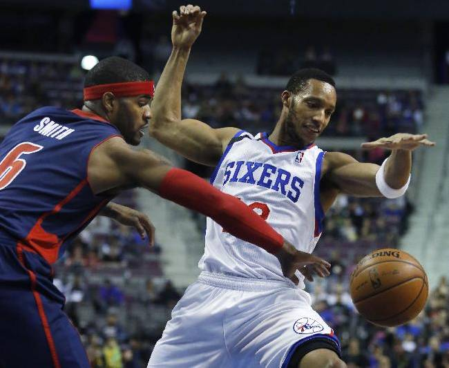 Detroit Pistons forward Josh Smith (6) steals the ball from Philadelphia 76ers forward Evan Turner during the first half of an NBA basketball game on Sunday, Dec. 1, 2013, in Auburn Hills, Mich