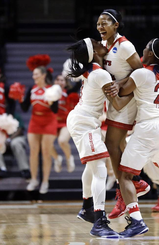 10ThingstoSeeSports - St. John's guard Briana Brown, center, celebrates with Aliyyah Handford, left, and Keylantra Langley (20) after Brown hit a 3-point shot to give St. John's a 71-68 win over Southern California in an NCAA women's college basketball first-round tournament game Saturday, March 22, 2014, in Knoxville, Tenn