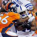 Indianapolis Colts running back Ahmad Bradshaw is stopped by Denver Broncos outside linebacker Nate Irving (56) during the first half of an NFL football game, Sunday, Sept. 7, 2014, in Denver The Associated Press