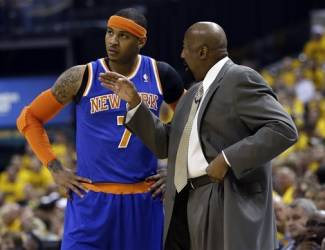 New York Knicks head coach Mike Woodson talks to Carmelo Anthony (7) during the first half of Game 6 of an Eastern Conference semifinal NBA basketball playoff series against the Indiana Pacers Saturday, May 18, 2013, in Indianapolis. (AP Photo/Darron Cummings)
