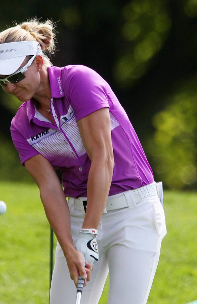 Ryann O'Toole hits a chip shot on the fourth hole at the Canadian Pacific Women's Open golf tournament in London, Ontario, Thursday, Aug. 21, 2014