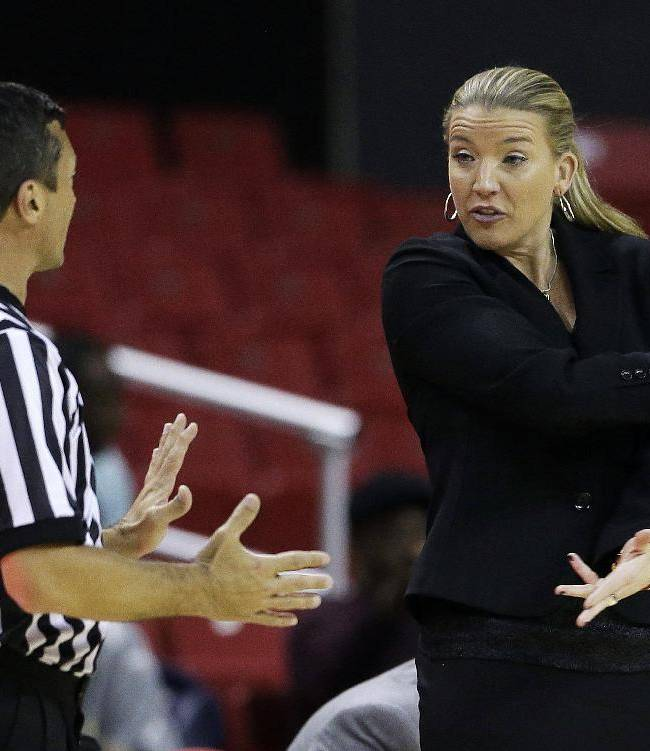 Siena head coach Ali Jaques, right, speaks with an official in the second half of an NCAA college basketball game against Maryland in College Park, Md., Monday, Dec. 9, 2013