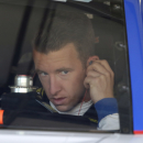 A.J. Allmendinger makes adjustments in his car before practice for the NASCAR Sprint Cup Series auto race Friday, June 26, 2015, in Sonoma, Calif. (AP Photo/Eric Risberg)