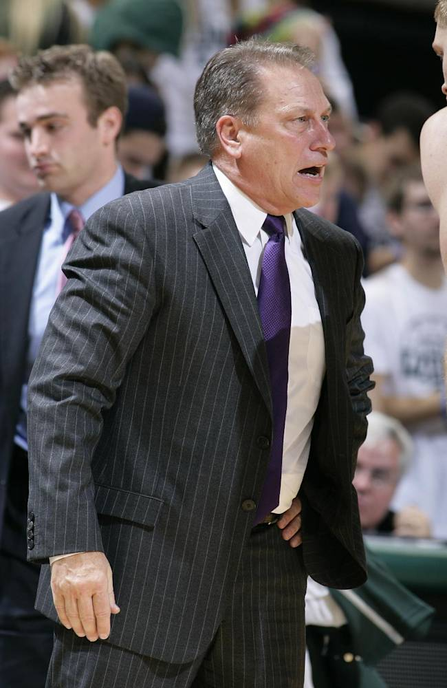 Michigan State coach Tom Izzo talks to Russell Byrd during the second half of an NCAA college basketball exhibition game against IUP, Monday, Nov. 4, 2013, in East Lansing, Mich. Michigan State won 83-45