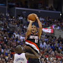 Portland Trail Blazers forward Nicolas Batum, top, of France, puts up a shot as Los Angeles Clippers guard Jamal Crawford defends during the second half of an NBA basketball game, Wednesday, Feb. 12, 2014, in Los Angeles The Associated Press