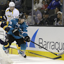 San Jose Sharks' Logan Couture (39) moves the puck past Nashville Predators' James Neal during the third period of an NHL hockey game Saturday, Dec. 13, 2014, in San Jose, Calif The Associated Press