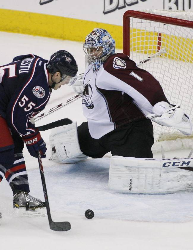 Columbus Blue Jackets' Mark Letestu (55) misses from short range against Colorado Avalanche goalie Semyon Varlamov (1) during the third period of an NHL hockey game, Tuesday, April 1, 2014, in Columbus, Ohio